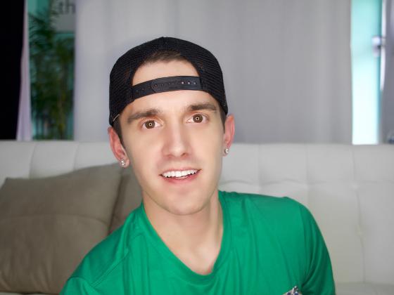 Image: Josh Robbins wearing a green shirt and a backwards cap
